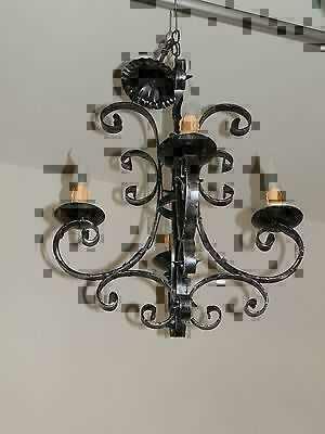 Lampadario medioevo a 4 luci in ferro battuto con candele for Oggetti da appendere